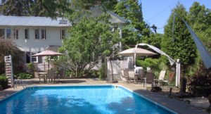"alt=""Full view of in ground swimming pool at hallauer house b & b"""