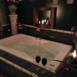 "alt=""asian spa with whirlpool tub, candles, and wine"""