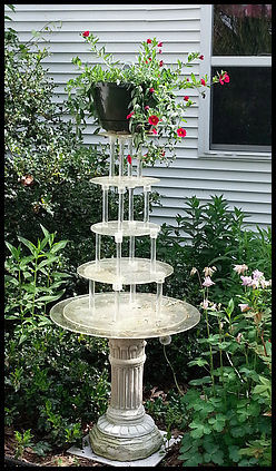 "alt=""five tier wedding cake stand on a pedestal with flower planter on top"""