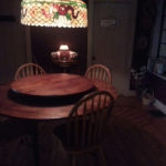 "alt=""round cherry lazy susan dining table in small dining room"""