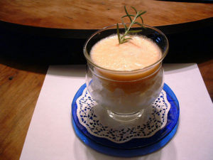 "alt=""cup of cold melon soup with topping of whipped cream served at breakfast"""