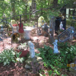 "alt=""garden with variety of old musical instruments"""