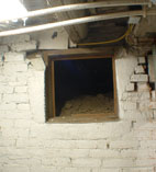 "alt=""basement opening into hiding place below the hole in floor above"