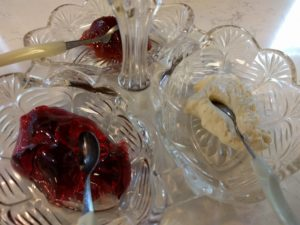 Devonshire Cream, grape jelly, and strawberry jam