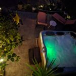 "alt=""out door hot tub in green light"""