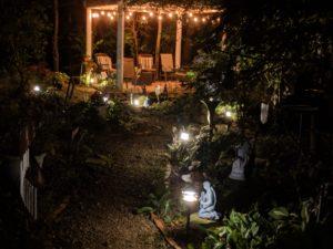 """alt:""""pavilion lit up at night"""""""