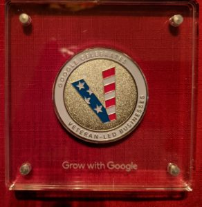 "alt:""challenge coin from Google"""