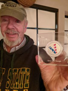alt:'close up joe with challenge coin""