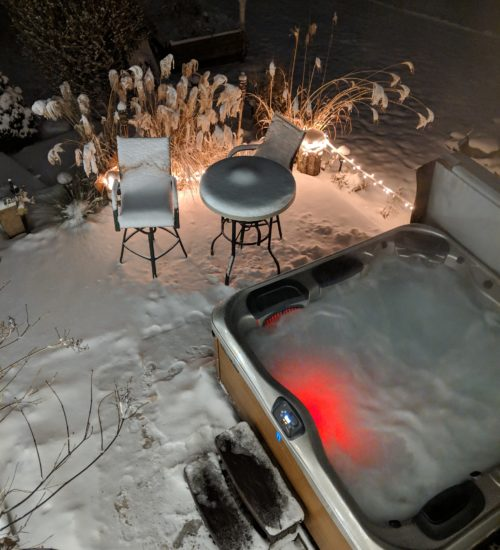 "alt:""outdoor hot tub in snow"""