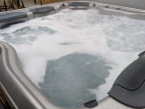 """alt:""""oudoor hot tub with jets on"""""""